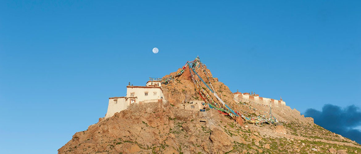 The monastery stands on a reddish mountain rising from the ground, which is called the Sandor Bairi Mountain by the believers.