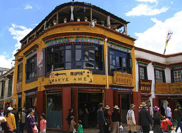 Shopping at Barkhor Street. There are various local Tibetan arts, crafts, and tasty cuisines in this market.