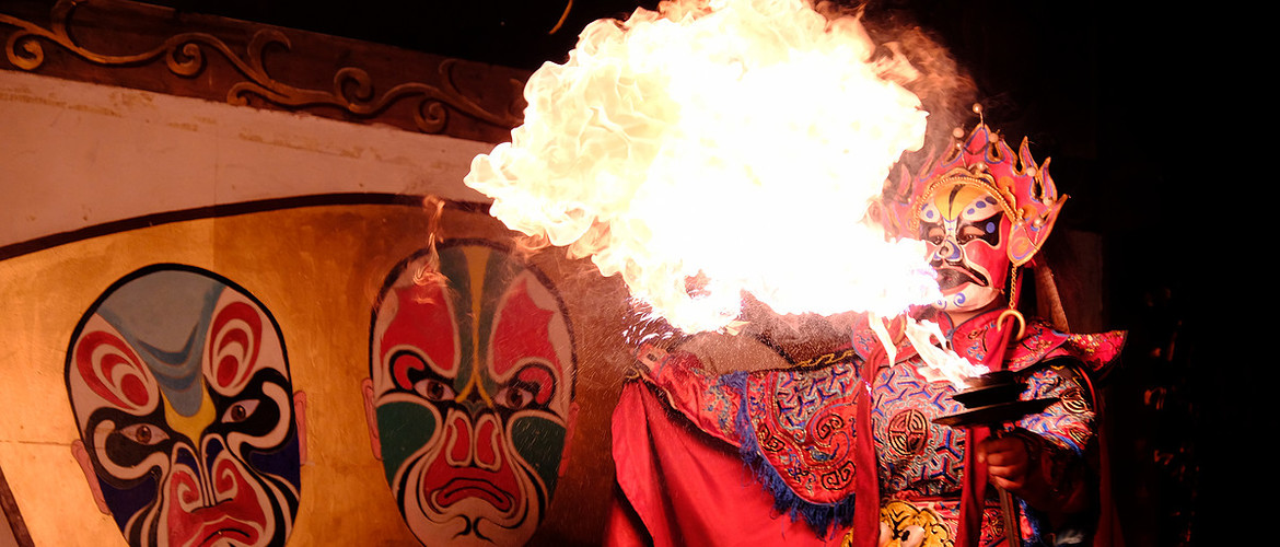 Changing face and flaming are unique acrobatics in Sichuan opera