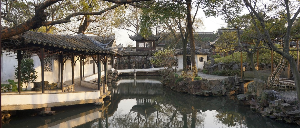 The classical landscape garden in Suzhou which contains lots of pools, meandering rock paths, little hills, old trees and flowers.