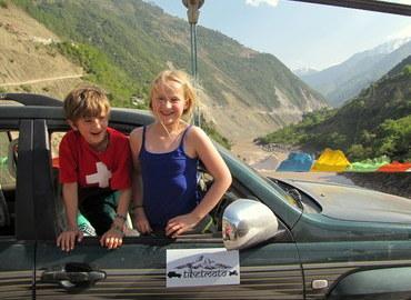 Kids in a jeep, Tibet.