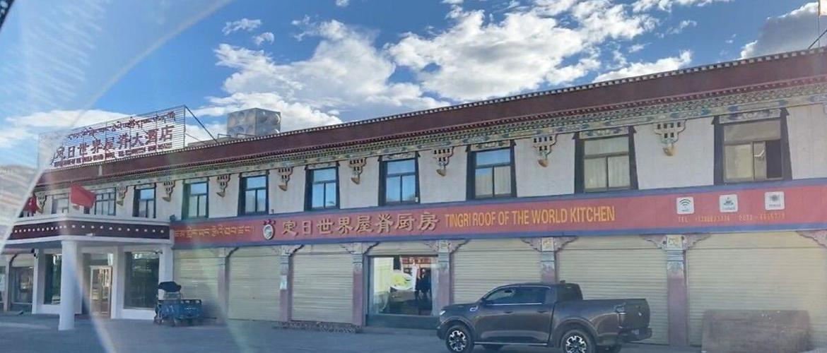 The outer appearance of Tingri roof of the world hotel is a 2 storey building.