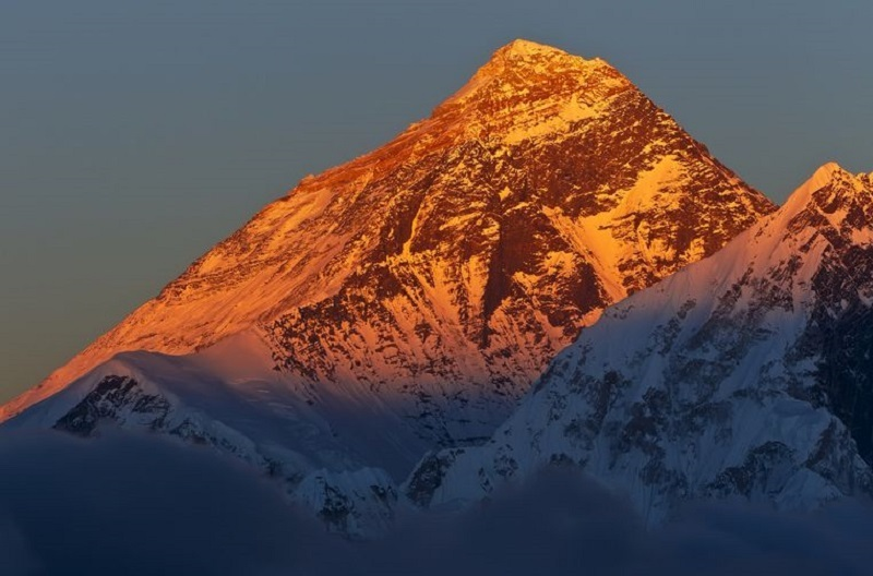 You are likely to see the golden submmit of Mt. Everest in April and May.