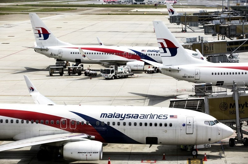 Planes belong to Malaysia Airlines.