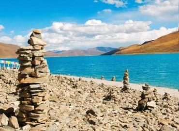 You will see the Mani stones at the lake side or the foot of the mountain in Tibet. The sky is very blue in Winter.
