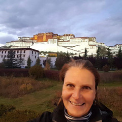 Stefanie Trippler stands in front of  the Potala Palance