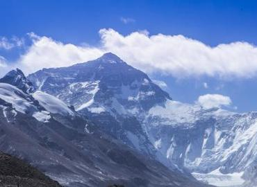 Mount Everest is situated between China and Nepal with 8848 meters high, which is the highest peak in the world.