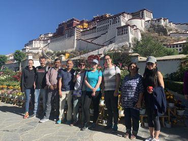 group photo with background of Potala Palace