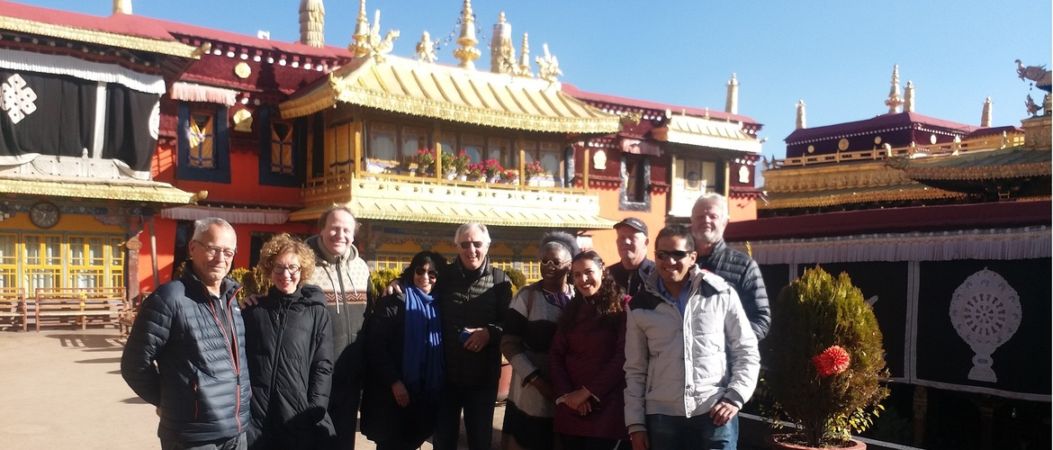 Tourists posed for a group photo at the roof of Jokhang Temple.