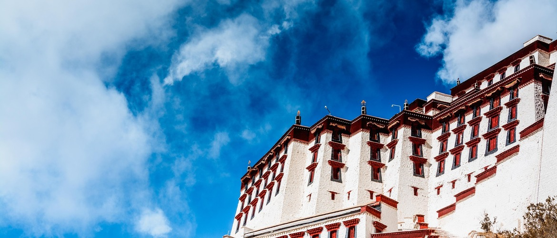 Grand Potala Palace shining under the sun.