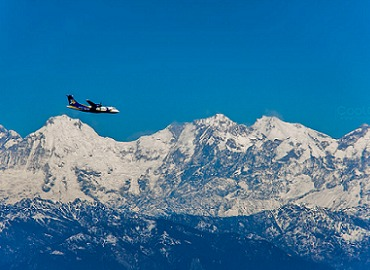 The plane flies over the Himalayas