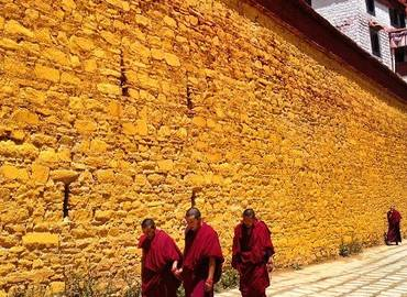 The feature of Ganden Monastery - yellow wall.