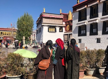 Three Tibetan women at the gate of Jokhang Temple.