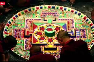 Completing the sand mandala