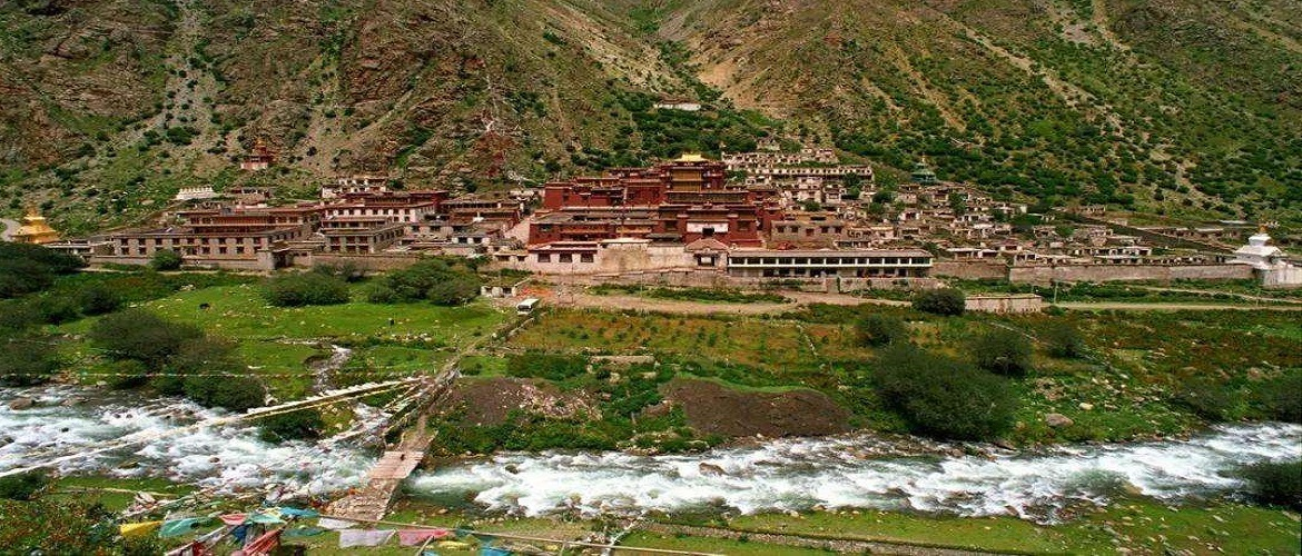 Tsurphu Monastery sits at the base of the mountain.